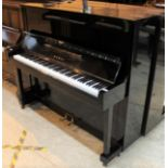 Kawai (c1962) An upright piano in a traditional style bright ebonised case