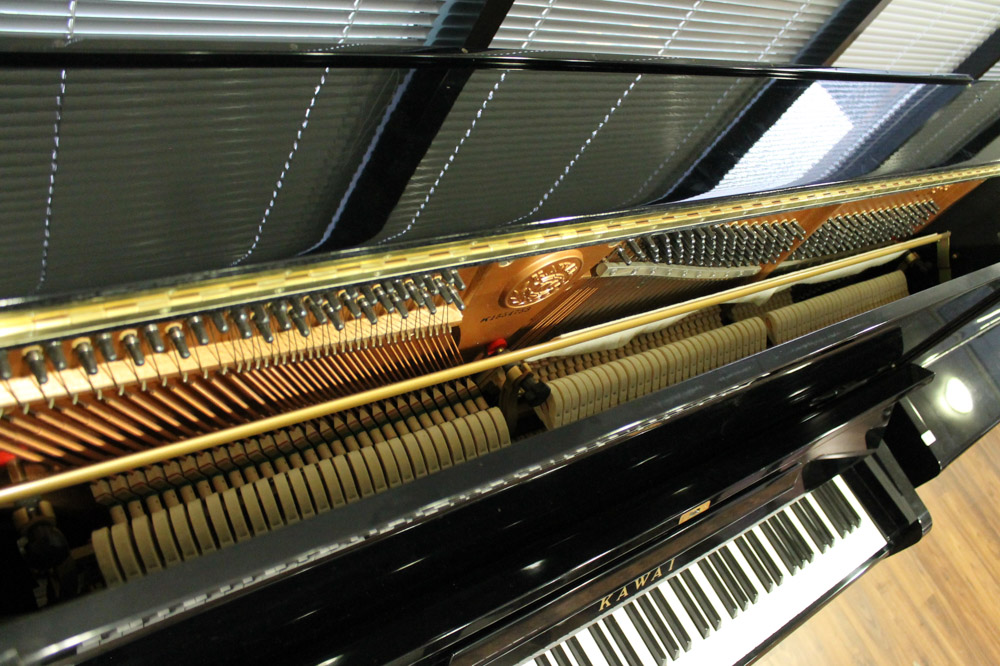 Kawai (c1985) An upright piano in a traditional bright ebonised case; - Image 5 of 5