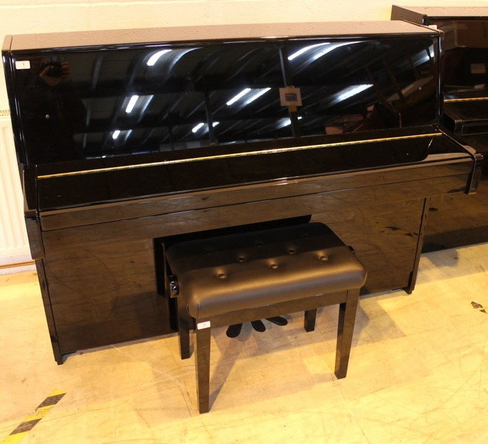 Kawai (c2007) A Model K-15 upright piano in a bright ebonised case; together with a stool.