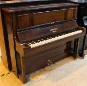 Bechstein (c1900) An upright piano in a rosewood case.