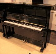 Yamaha (c1959) A Model U2A upright piano in a bright ebonised case.