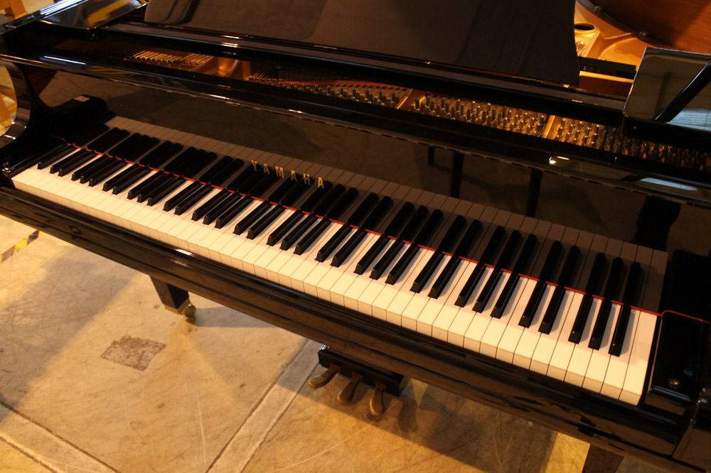 Yamaha (c2009) A 5ft 6in Model GC2 grand piano in a bright ebonised case on square tapered legs; - Image 5 of 8