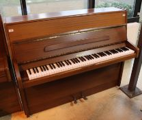 Knight (c1980) An upright piano in a modern style mahogany case