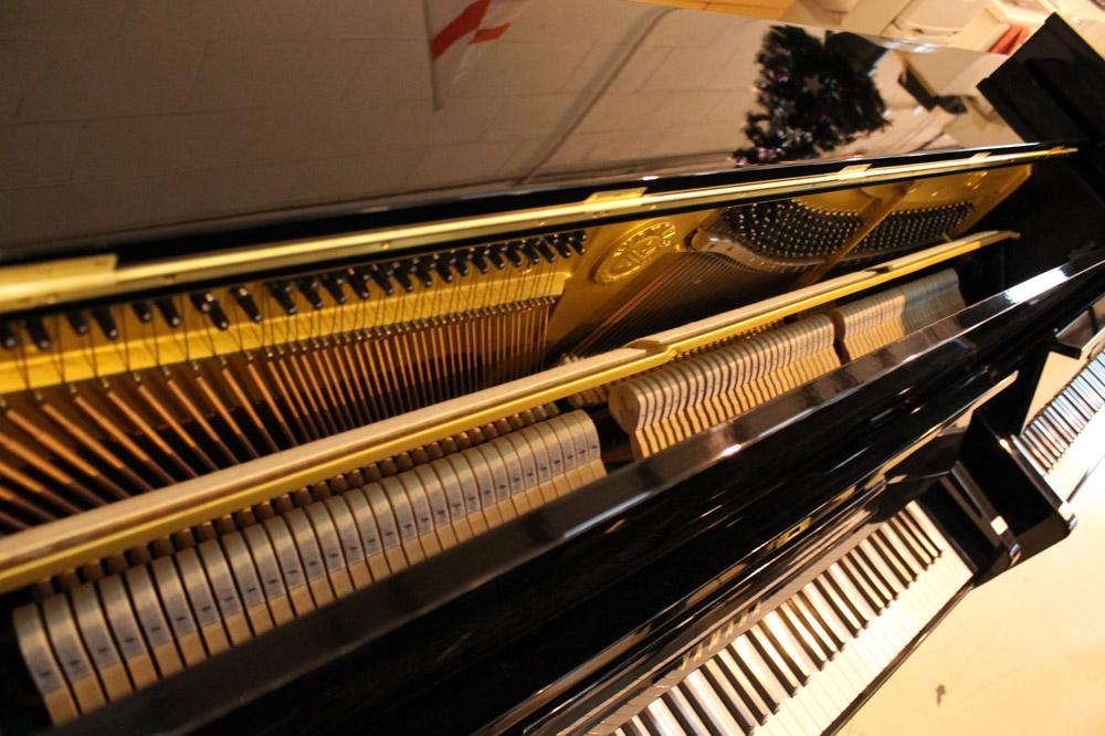 Yamaha (c1977) A Model U1H upright piano in a bright ebonised case. - Image 3 of 5