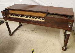 Erard A square piano in a flame mahogany case on plain turned supports with applied garlands.