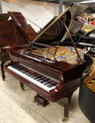 Blüthner (c1920) A 6ft 3in grand piano in a re-polyestered mahogany case on square tapered legs.
