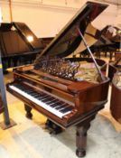 Steinway (c1910) A 5ft 10in Model O grand piano in a bright ebonised case on square tapered legs;