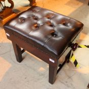 Piano Stool A mahogany concert adjustable stool with button upholstered leather top.