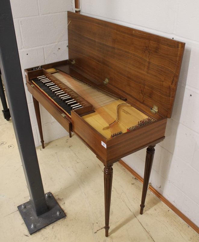 Morley clavichord A Morley clavichord in a walnut case on turned and fluted legs.