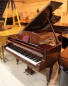 Bosendorfer (c1971) A 6ft 7in grand piano in a bright mahogany case; together with a stool.