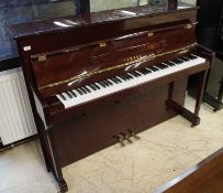 Yamaha (c2003) A Model P112N upright piano in a bright mahogany case; together with a stool.