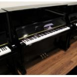 Kawai (c1962) A Model K-20 upright piano in a bright ebonised case.