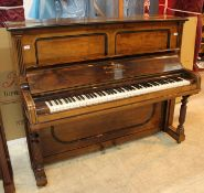 Steinway (c1900) An upright piano in a rosewood case.