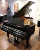 Steinway (c1974) A 6ft 11in Model B grand piano in a bright ebonised case on square tapered legs;