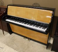 Schimmel (c1957) An upright piano in a modern style maple and ebonised trimmed case.