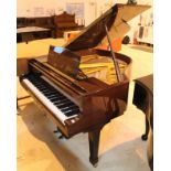 Blüthner (c1984) A 5ft 1in Model 11 grand piano in a bright mahogany case on square tapered legs.