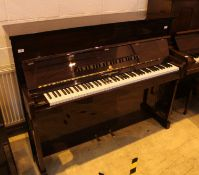 Broadwood (c1988) An upright piano in a traditional style mahogany case.