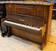 Bechstein (c1879) An upright piano in a figured walnut case.