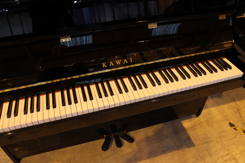 Kawai (c2007) A Model K-15 upright piano in a bright ebonised case; together with a stool. - Image 4 of 6
