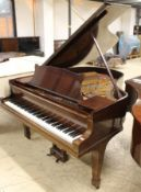 Steinway (c1929) A 5ft 7in Model M grand piano in a mahogany case on square tapered legs.