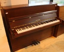 Hoffmann (c1986) A Model 117 upright piano in a modern style satin mahogany case.