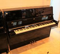 Niemeyer A recent upright piano in a modern style bright ebonised case; together with a stool.