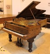 Steinway (c1880) A 9ft concert grand piano in a walnut case on sabre legs.