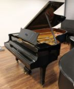 Steinway (c1971) A 6ft 11in Model B grand piano in a bright ebonised case on square tapered legs;