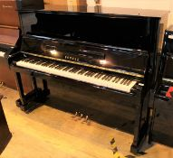 Yamaha (c1988) A Model U10BL upright piano in a bright ebonised case.
