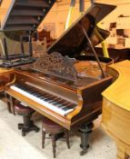 Blüthner (c1898) A 6ft 3in grand piano in a rosewood case on turned legs; together with 2 stools.