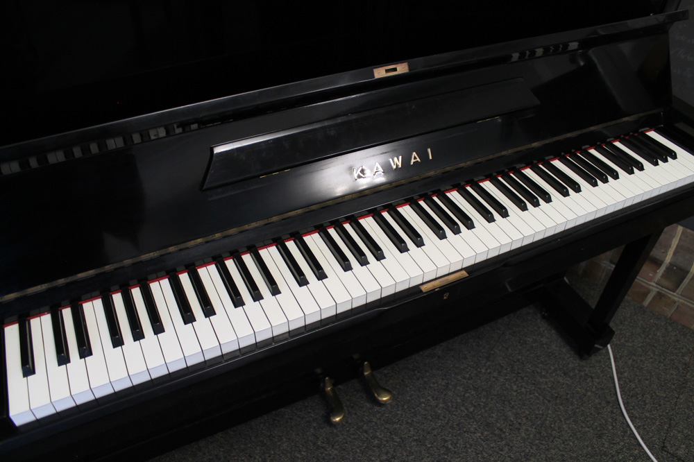 Kawai (c1962) An upright piano in a traditional style bright ebonised case - Image 3 of 5
