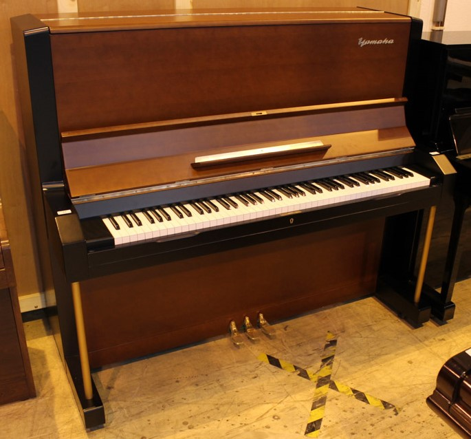 Yamaha (c1958) A Model U3B upright piano in a brown and black satin case.