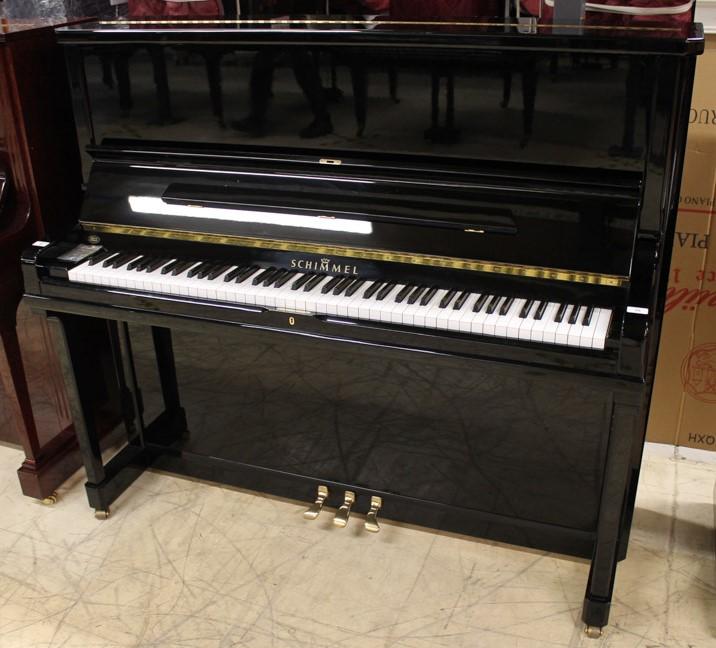 Schimmel (c1995) A Model 130 upright piano in a bright ebonised case.