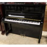 Schimmel (c1995) A Model 130 upright piano in a bright ebonised case.