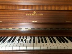 Steinway (c1976) A Model V upright piano in a modern style mahogany case.