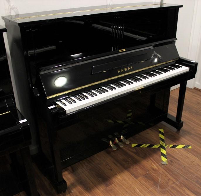 Kawai (c1961) A Model K-8 upright piano in a bright ebonised case.