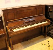 Steinway (c1925) A Model K upright piano in a mahogany case;