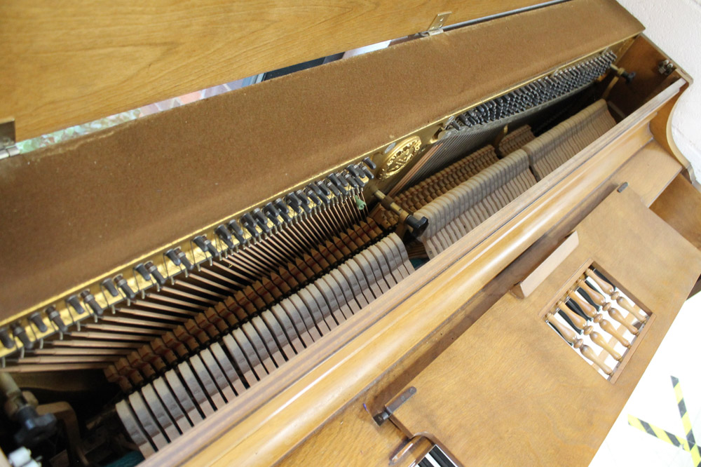 Yamaha (c1971) An upright piano in an American 'spinet' style case; together with a matching stool. - Image 6 of 6