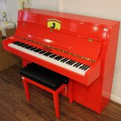 Upright Piano A recent upright piano in a modern style case decorated in the red Ferrari livery.