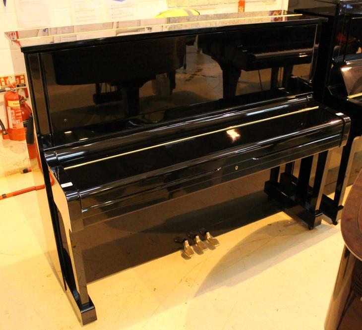 Yamaha (c1977) A Model U1H upright piano in a bright ebonised case. - Image 2 of 5