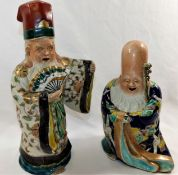 Two Japanese pottery glazed, polychrome enamel and gilt decorated figures of immortals,