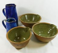 Five items of Studio pottery, comprised of two blue glazed stoneware jugs, 24.5cm high and 14.