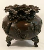 A Japanese bronzed koro, cast in the form of a bag tied up with a cord, with one foot lacking,