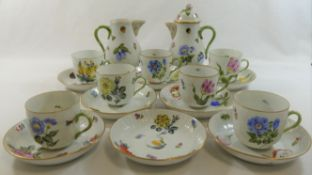 A Herend porcelain part coffee service, comprised of seven cups, eight saucers,