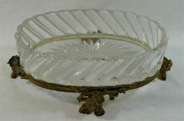 A oval Baccarat ormolu mounted glass dish, raised on four floral cast feet,