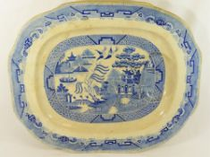 A large 19th century blue and white willow pattern meat platter by John Carr and Co.