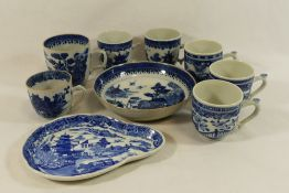 A Chinese porcelain blue and white coffee cup and saucer, cup 7cm high, saucer 14cm diameter,