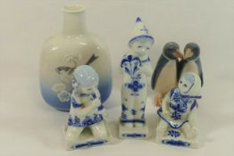 Five items of Royal Copenhagen, comprised of a penguin group, 9.5cm high, a small vase, 14.