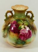 A Royal Worcester two-handled vase, hand painted with roses, signed A Food, with gilt detail,