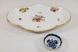 An 18th century Derby soft paste porcelain blue and white wine taster with leaf handle and